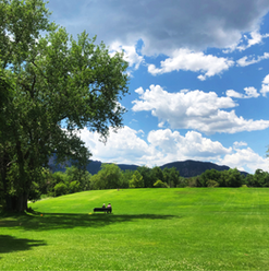 Two people enjoy a beautiful summer day at Scott Carpenter Park in Boulder