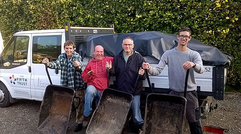 Students with wheel barrows