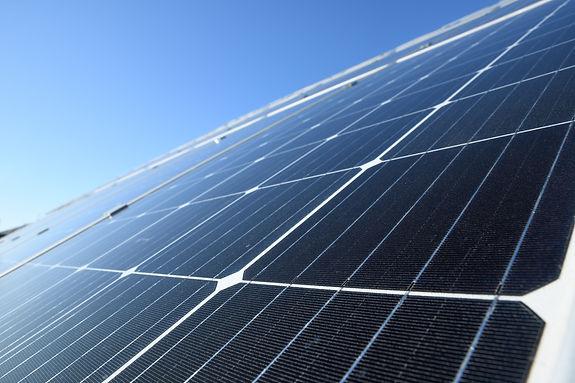 solar-panels-against-blue-sky-background