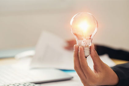 hand-holding-light-bulb-idea-concept-wit