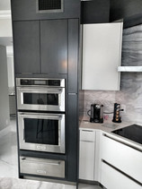 White Gloss and Stained kitchen