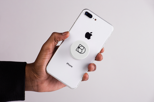 mockup-featuring-a-male-hand-showing-an-iphone-with-a-phone-grip-22157.png