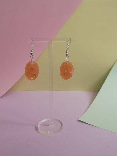 Glittery orange oval earrings