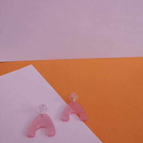 Squiggly pink earrings with glitter studs