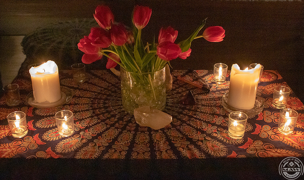 Tulips, geodes, and candles on an altar for a New Moon ceremony