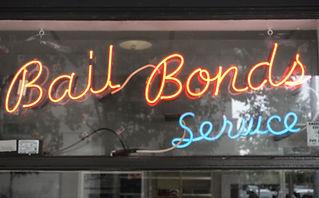 Neon Bail Bond sign in window.jpg