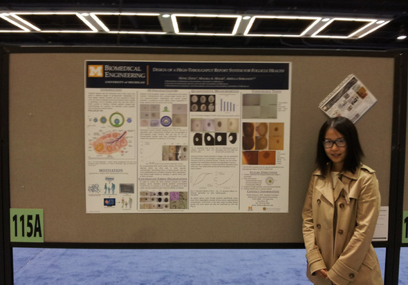 Graduate students Hong Zhou and Jiwon Kim present their research at the annul BMES meeting in Seattle, Washington.