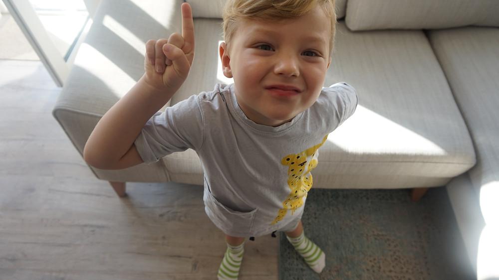 Child wearing platfus rehabilitation socks at home