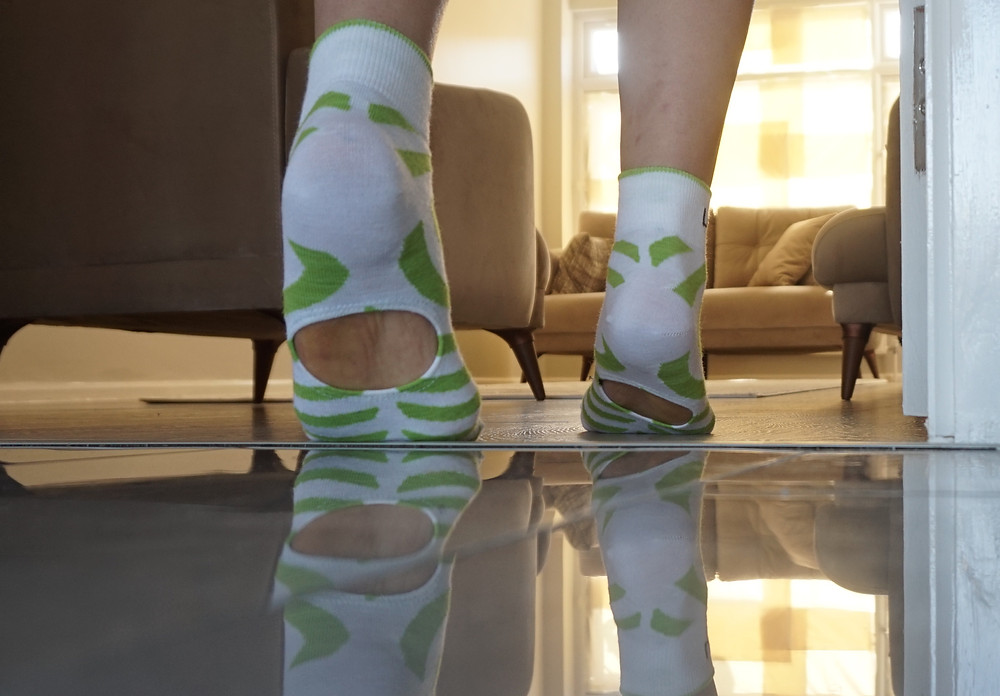 Patient wearing Rehabilitation Socks for flat feet correction.