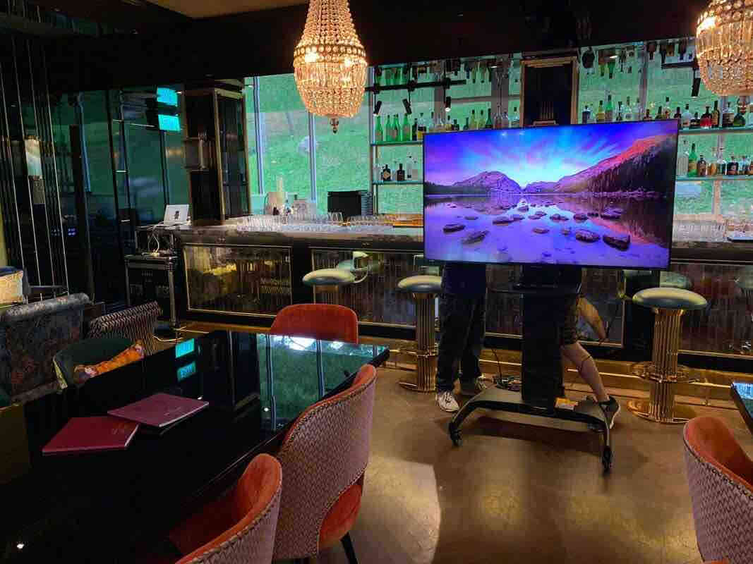 Big Plasma screen being used in a bar in London