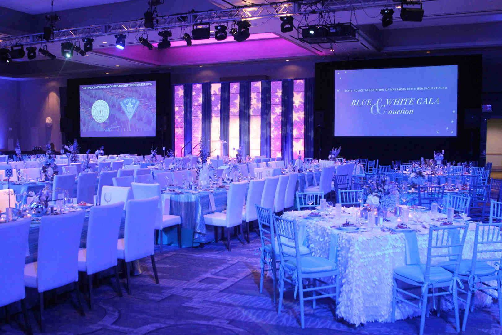 Projecotor screens at an event in London