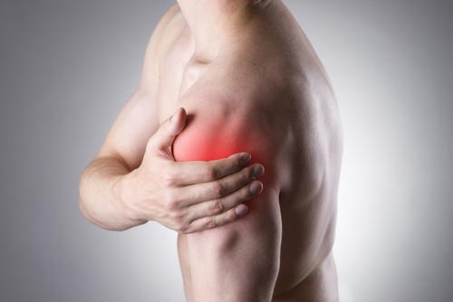 man holding sore shoulder