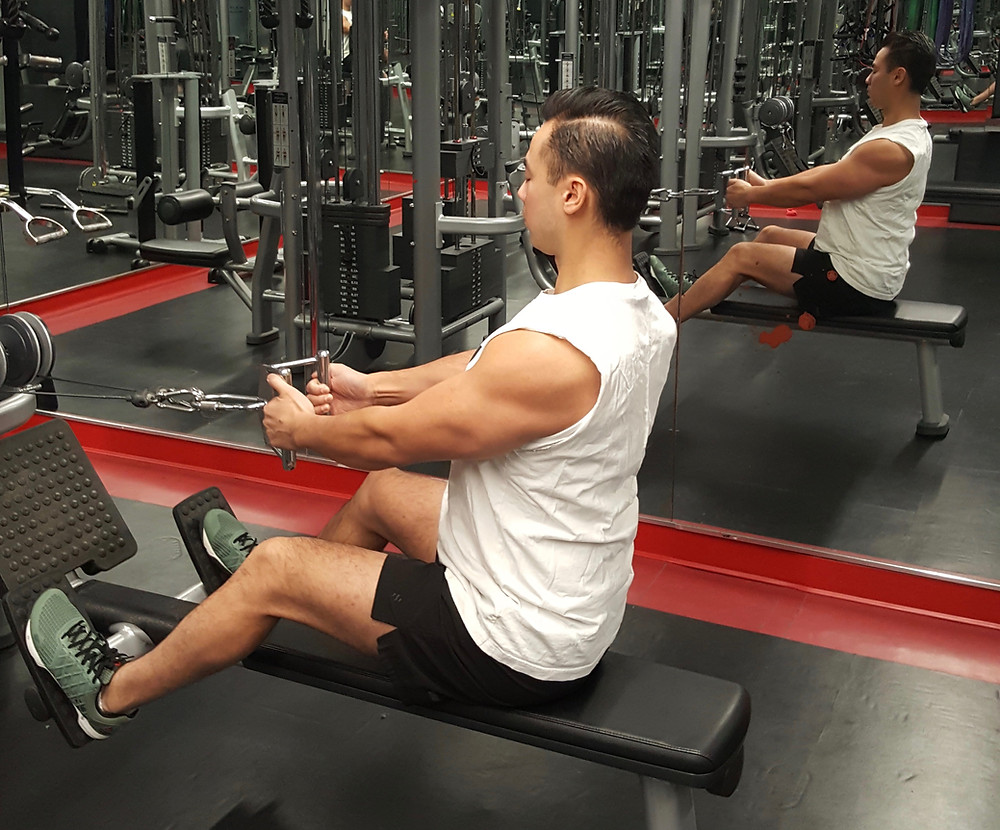 Rebuild Physiotherapy Eric Lau demonstrating how to perform a seated cable back row