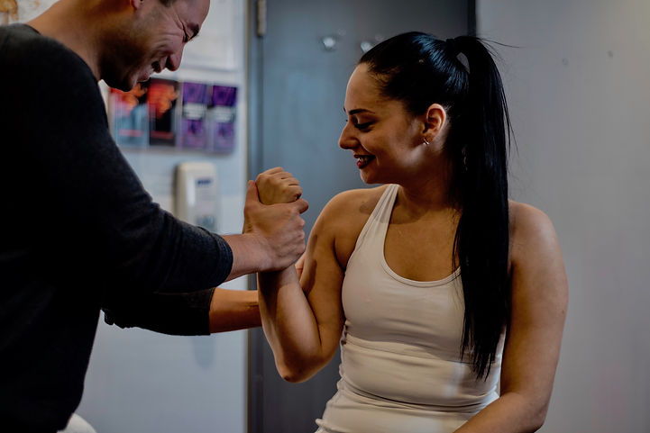 Physiotherapist treating a patient's elbow