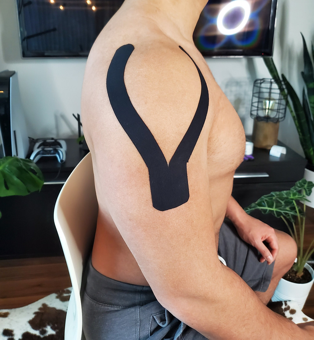 Kinesiology tape Y strip around the deltoid