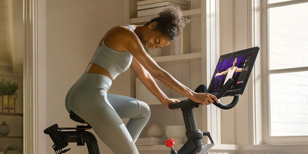 Women riding on Peloton stationary bike