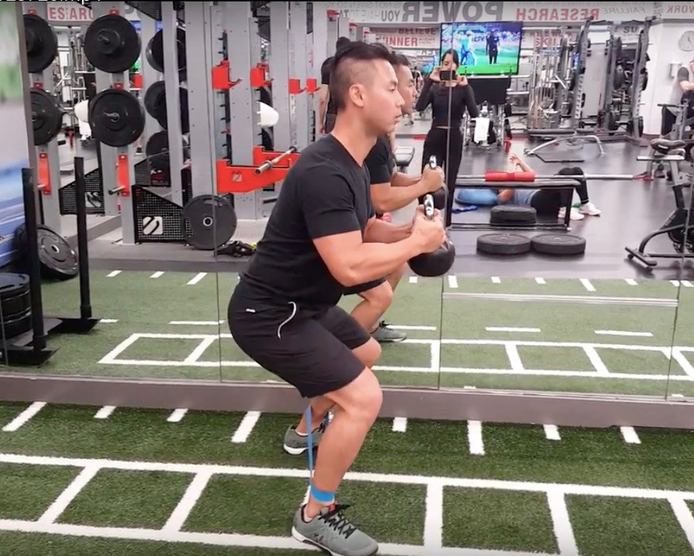 Rebuild Physiotherapy Knee and hip exercise: Banded Cowboy Walk Exercise with Kettlebell