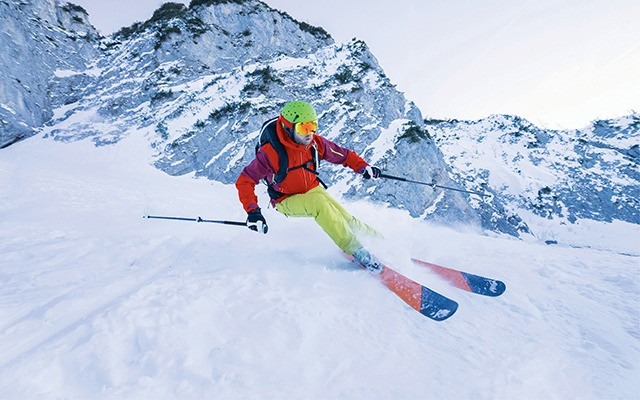 Skier turning while skiing downhill