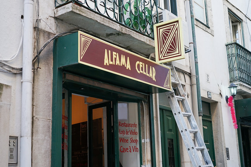Basile Jeandin |Alfama Cellar Rebranding | Restaurant Branding hand painted on wood signage