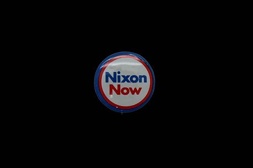 NIXON NOW BUTTON