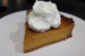 a slice of Pumpkin Pie on a plate