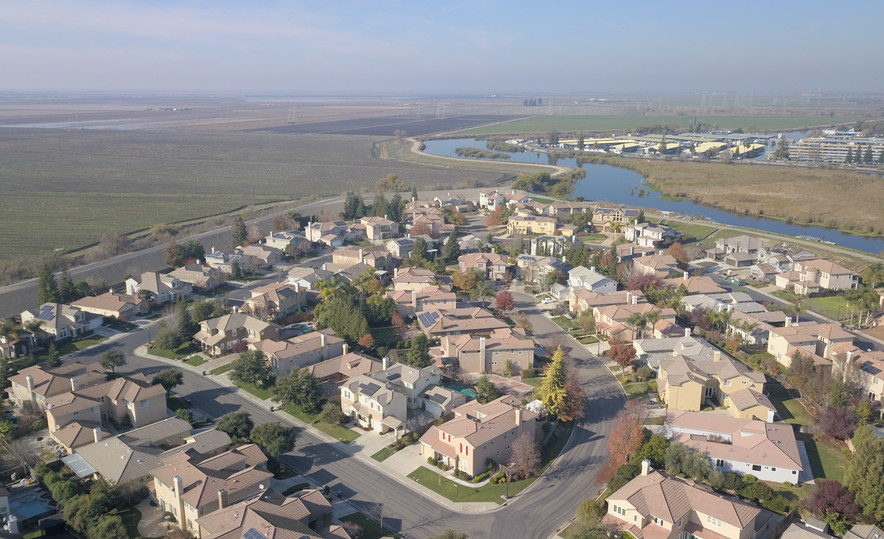 Aerial of a house near the Delta in Stockton.