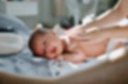 doula gives newborn massage