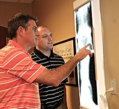 Chiropractors in Cary, NC evaluating an X-Ray at Staker Chiropractic Center