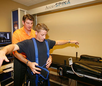 Dr. Staker preparing a patient for Spinal Decompresion IDD Therapy on the Accu-Spina.