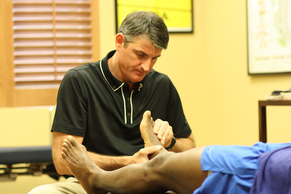 Dr. Staker evaluating foot pain