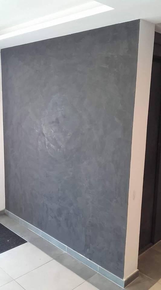 Application du stuco sur mur