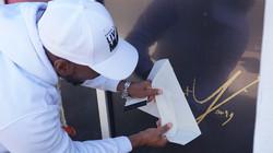 Robert Young Signing his Art Basel 2019 Artwork