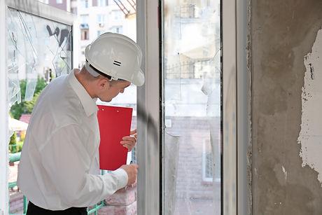 Insurance adjuster inspecting abandoned