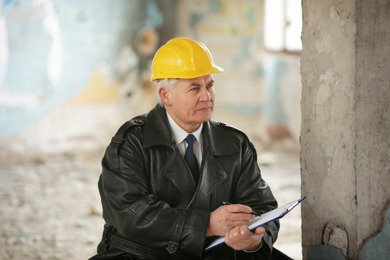 Insurance adjuster in devastated room of