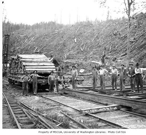 Track crew and railroad ties on flatbed