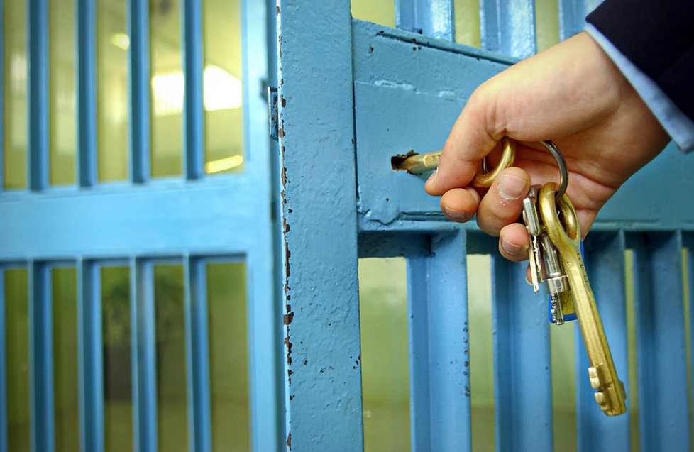Police officers locks the door in prison