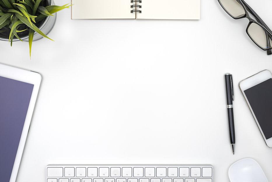 frame-with-office-equipment-white-desk.j