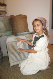 young visitor in piriod attire