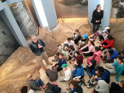 Kids in a guided tour of the museum floor