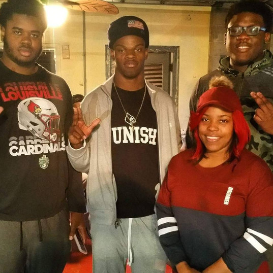 Nichelle with NFL Star Lamar Jackson and friends