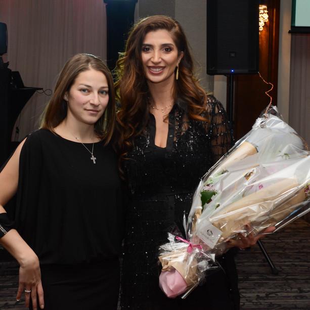 Nancy presenting flowers to Joyce Azzam