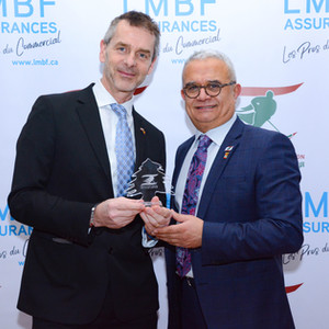 Presenting LIHF gift to Ambassador Johan by Charles El- Mir