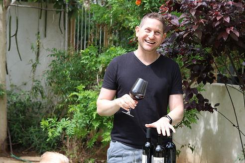Ari tasting wine.JPG