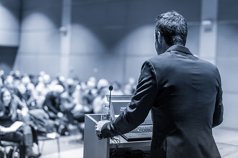 Speaker giving a talk on corporate Busin