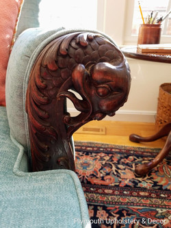 Dragons carved into chair arms