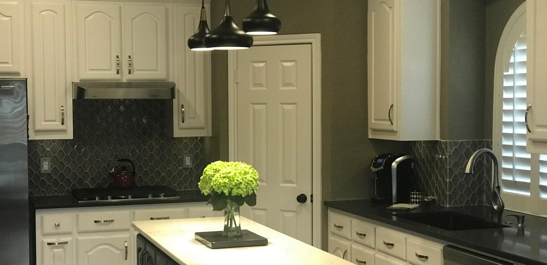 Black and white quartz kitchen.png