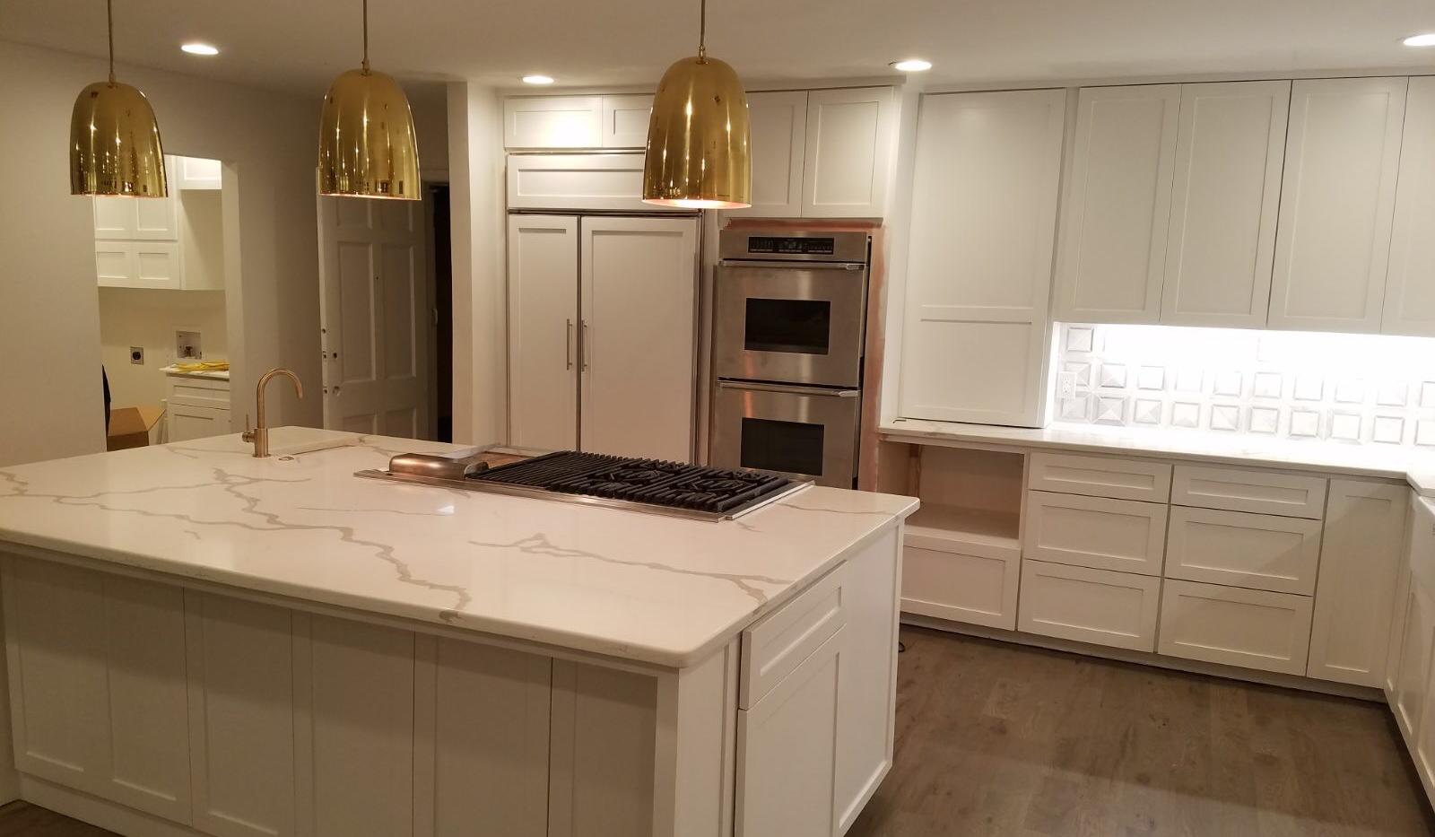 White quartz island kitchen.png
