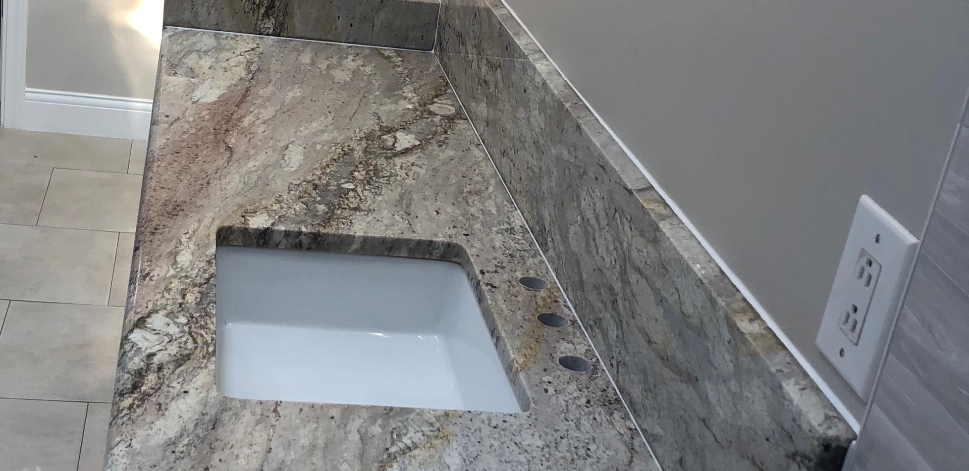 Exotic_granite_countertop_sink.jpeg