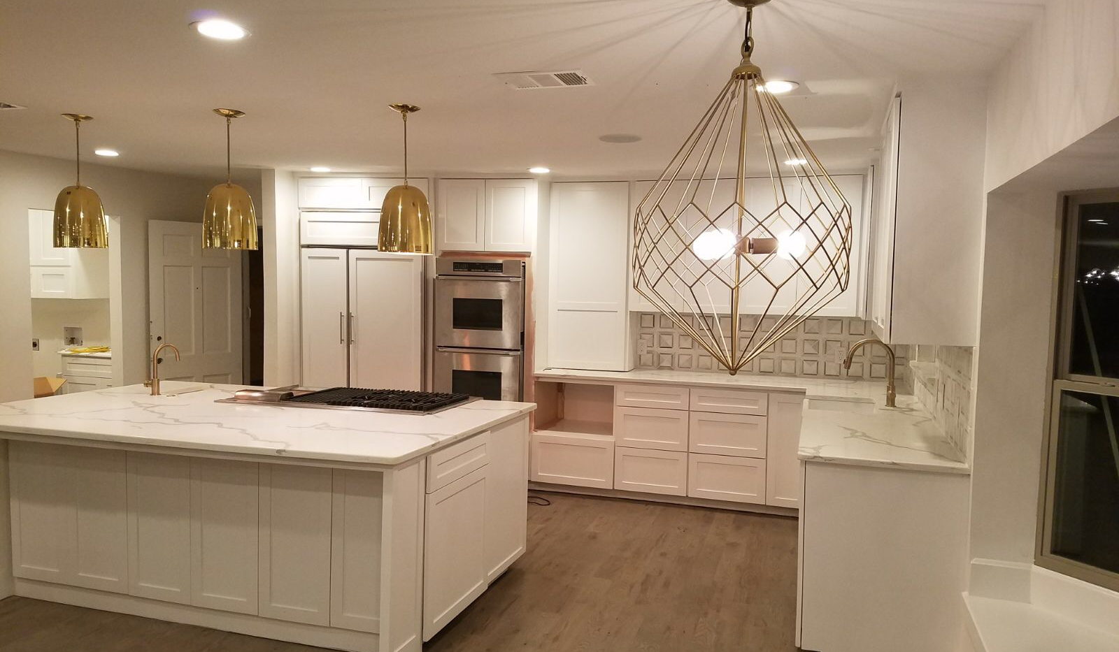 All white kitchen with gold accents.png