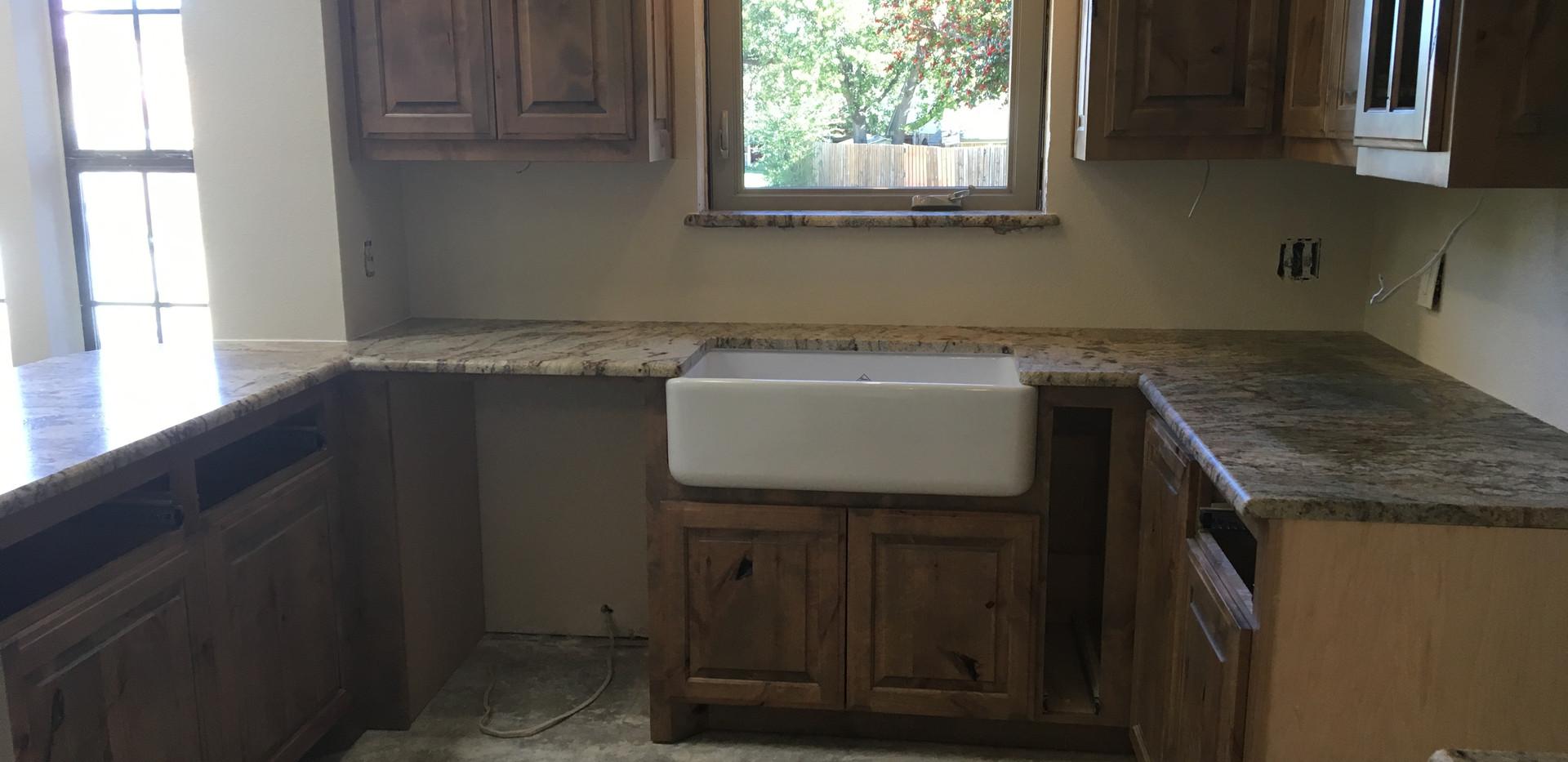 granite_rustic_countertop_kitchen_sink.J